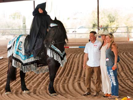 K2 in the arena with his sponsors from K2 Adventures Foundation, a woman in Arabian costume is riding him