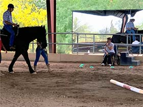 Alicia Nicole Stasinski, Camelot's newest PATH Intl Registered Instructor teaches a lesson in the arena